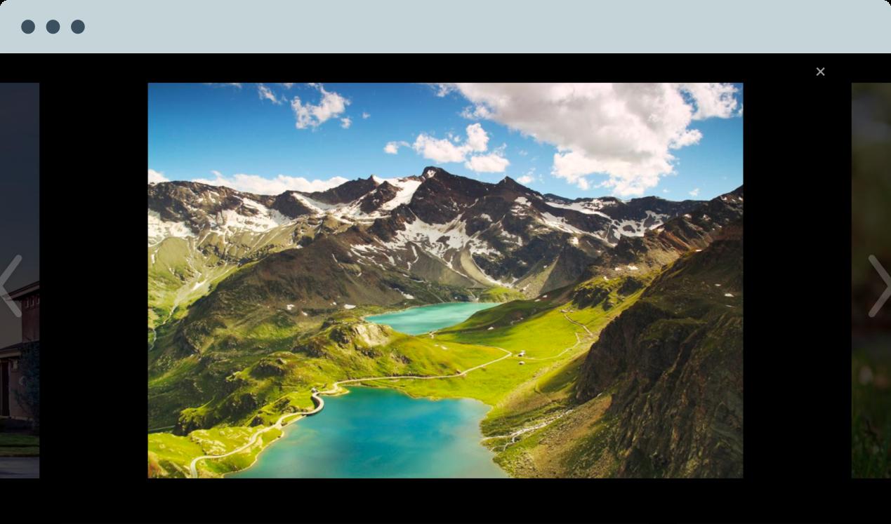 Image montrant un diaporama en plein écran avec une photo représentant des montagnes et des lacs